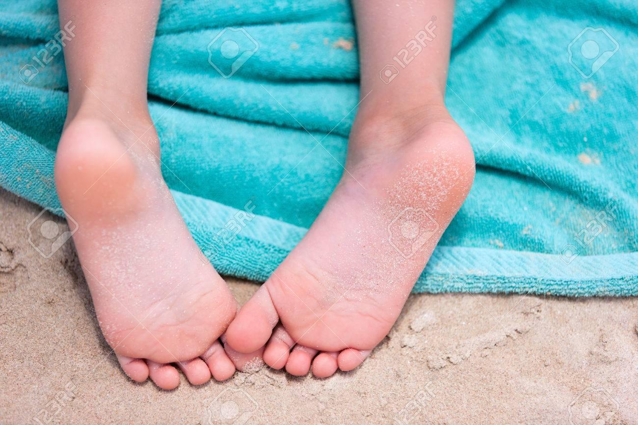 girlfeet Close up of a little girl feet on a beach towel Stock Photo - 30305443