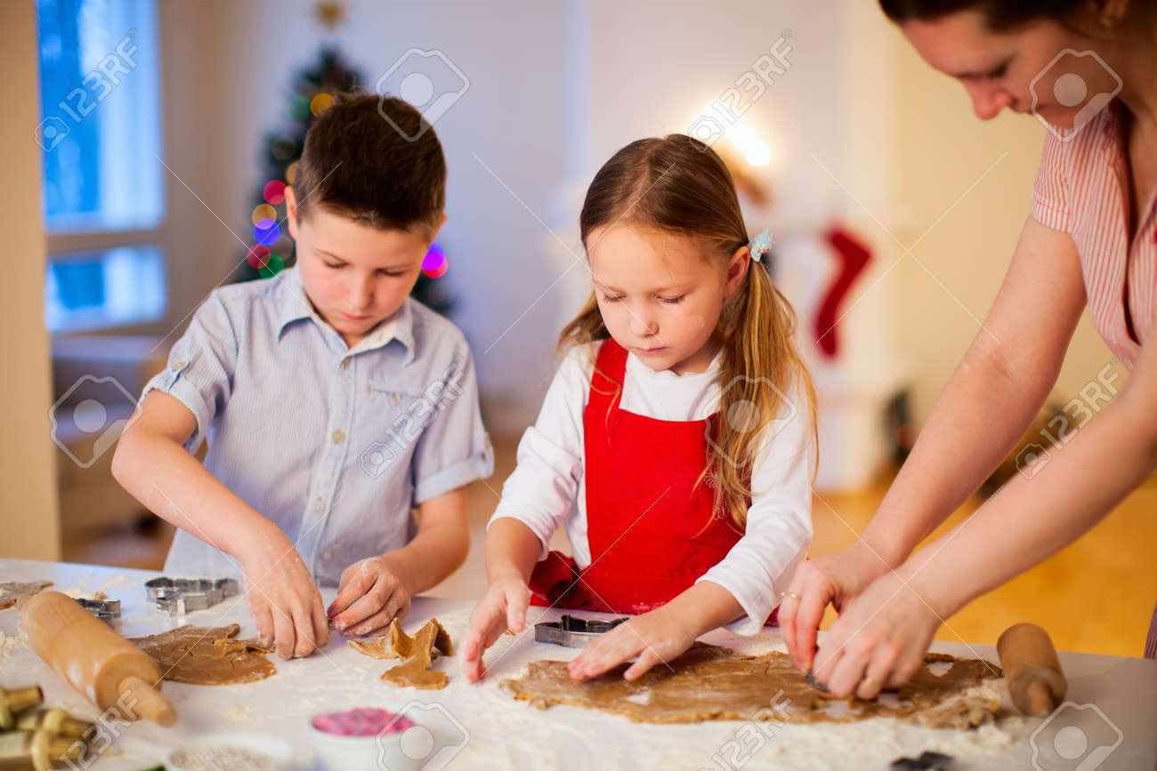 Family Baking Christmas Cookies At Home Stock Photo, Picture And ...