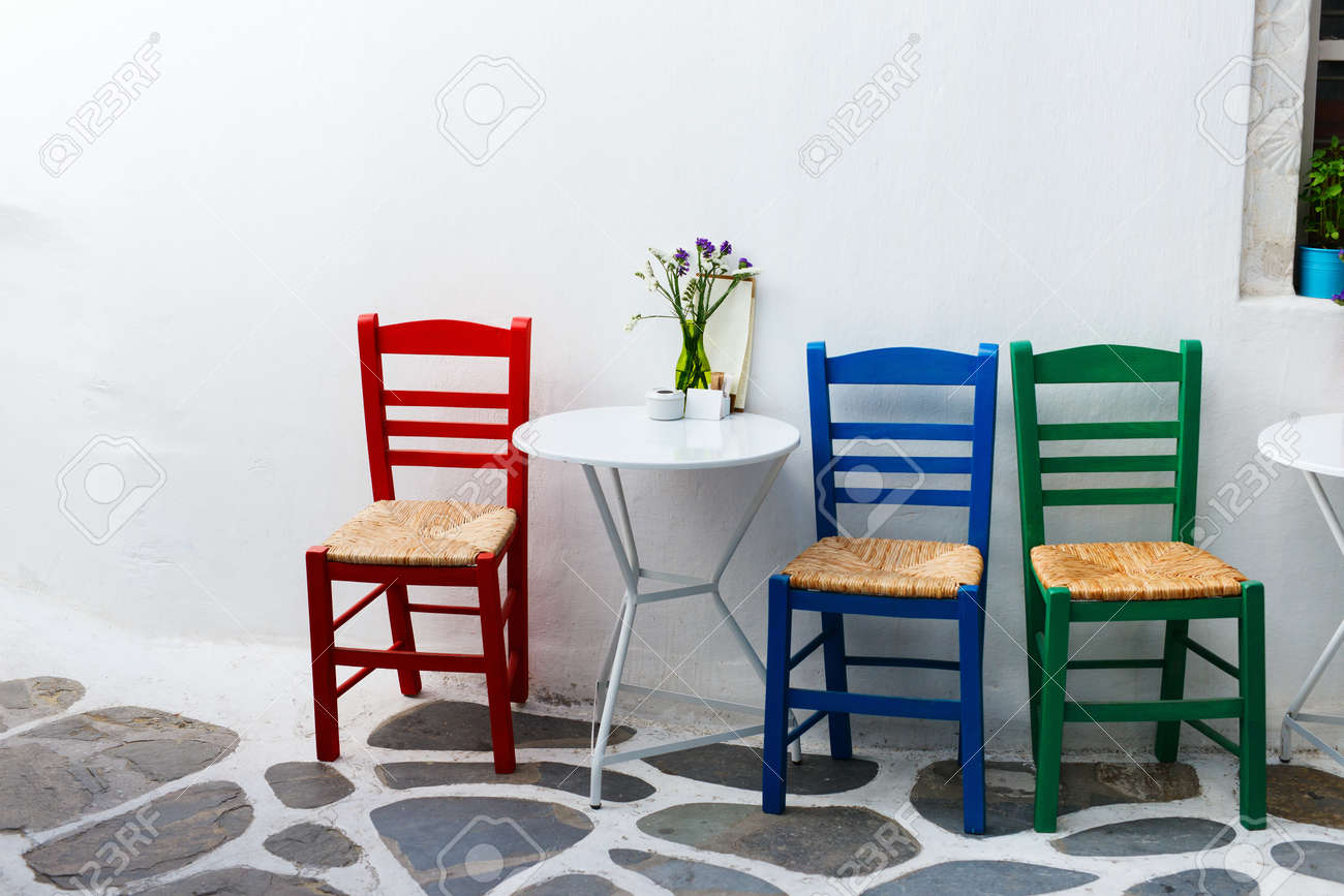 Beau Colorful Chairs And Table On Street Of Typical Greek Traditional Village  With White Houses On Mykonos