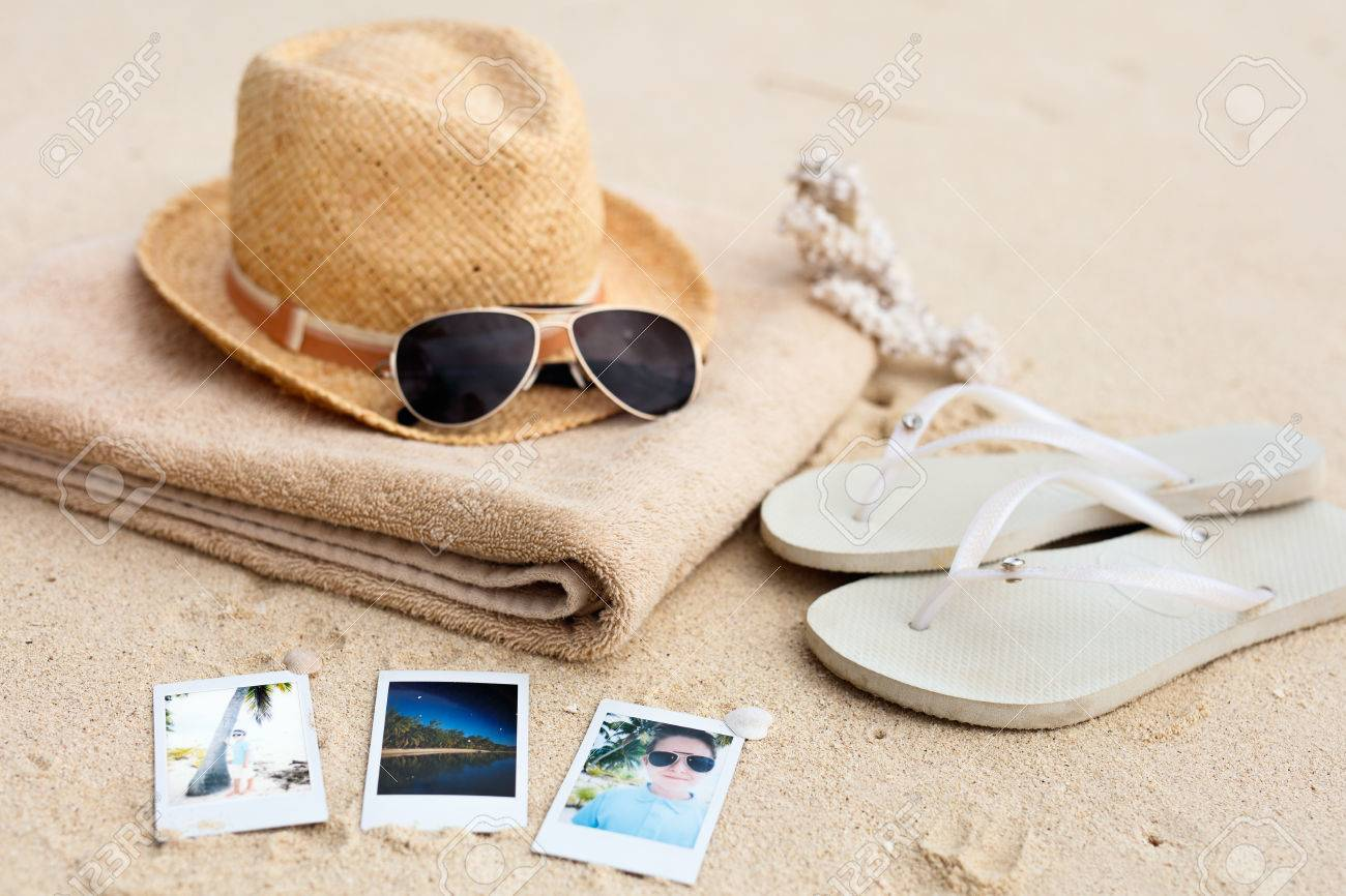 Straw hat, towel, sun glasses, flip flops and instant photos on a tropical beach - 49178186