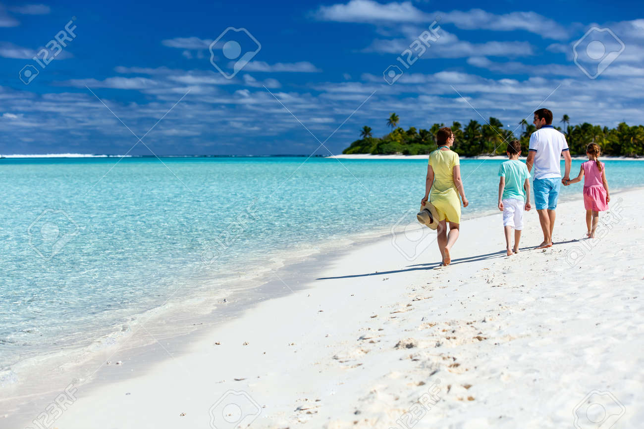 Happy beautiful family on a tropical beach vacation - 49178330