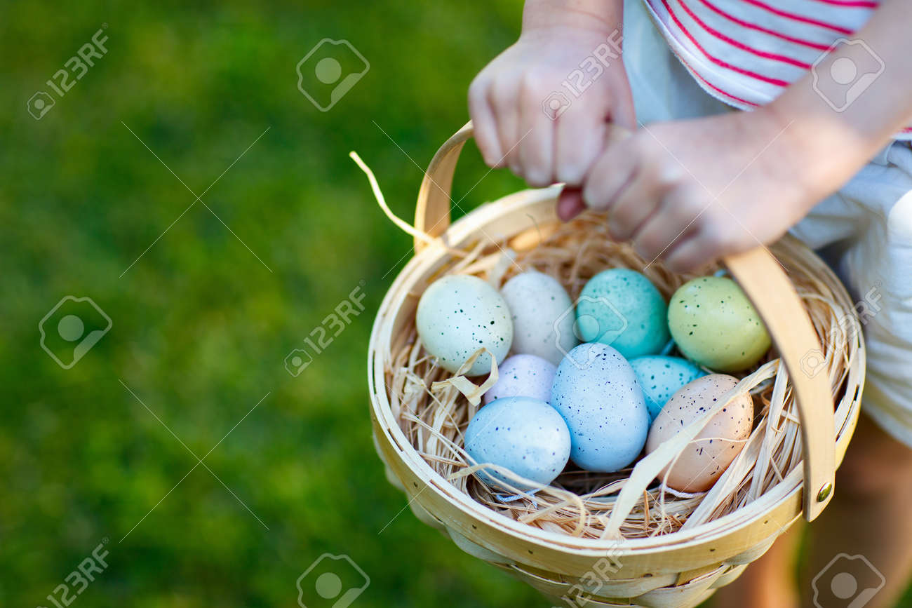 Close up of colorful Easter eggs in a basket - 51368601