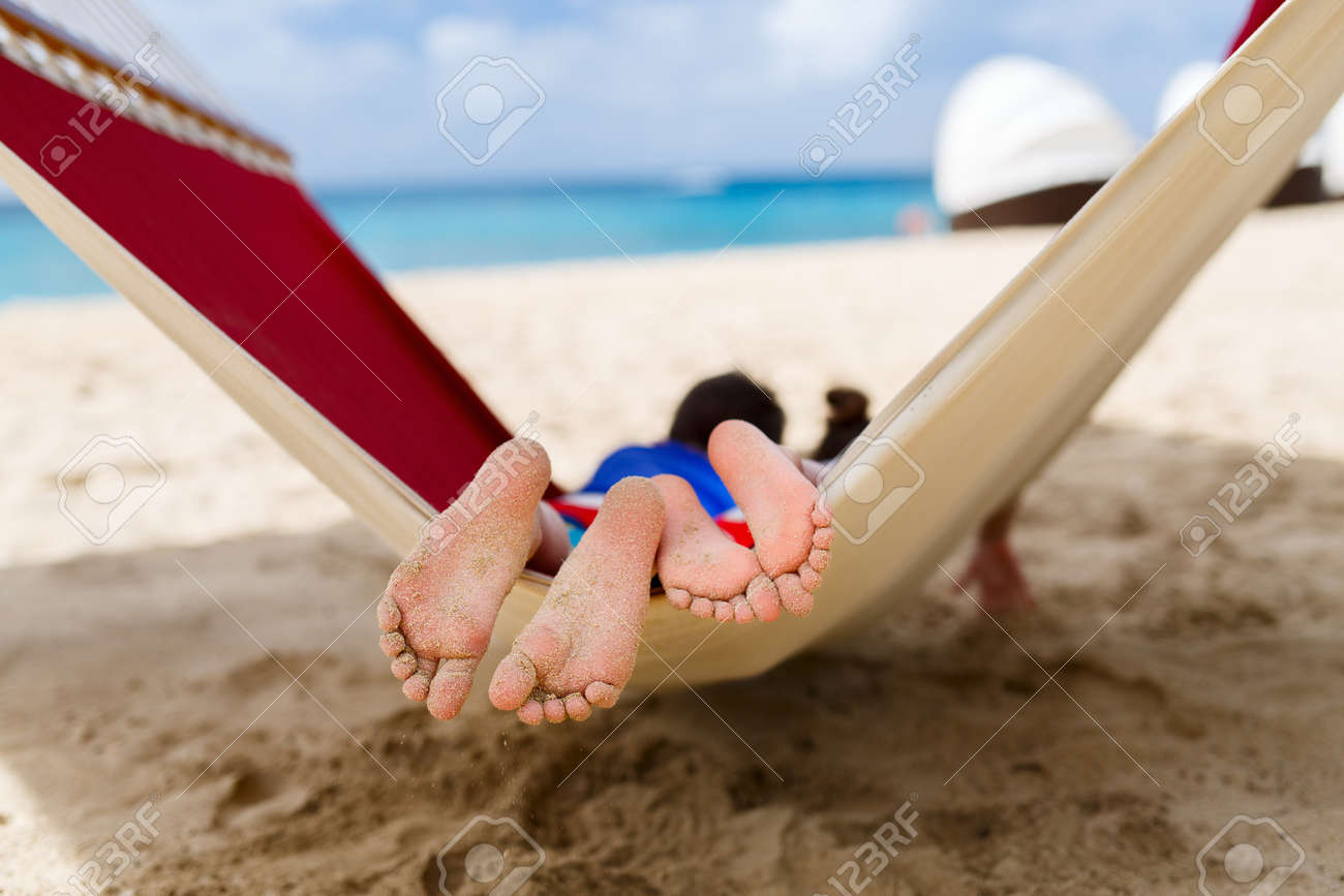 Brother and sister kids relaxing in hammock at tropical beach - 51368846