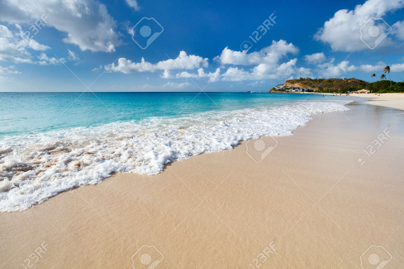 Idyllic tropical Darkwood beach at Antigua island in Caribbean with white sand, turquoise ocean water and blue sky - 51911697