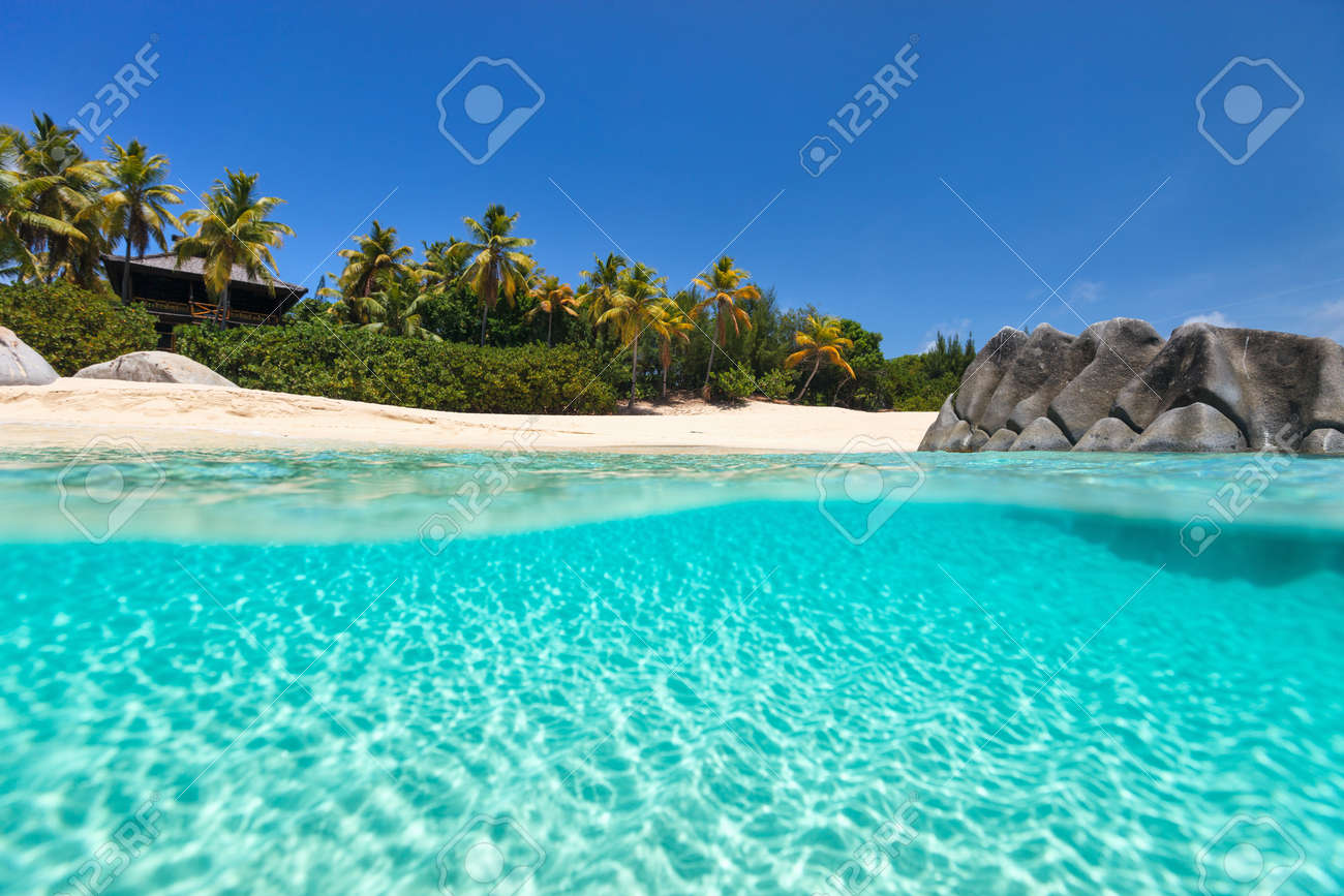 Beautiful tropical beach with white sand, turquoise ocean water and blue sky at Virgin Gorda, British Virgin Islands in Caribbean - 76485832