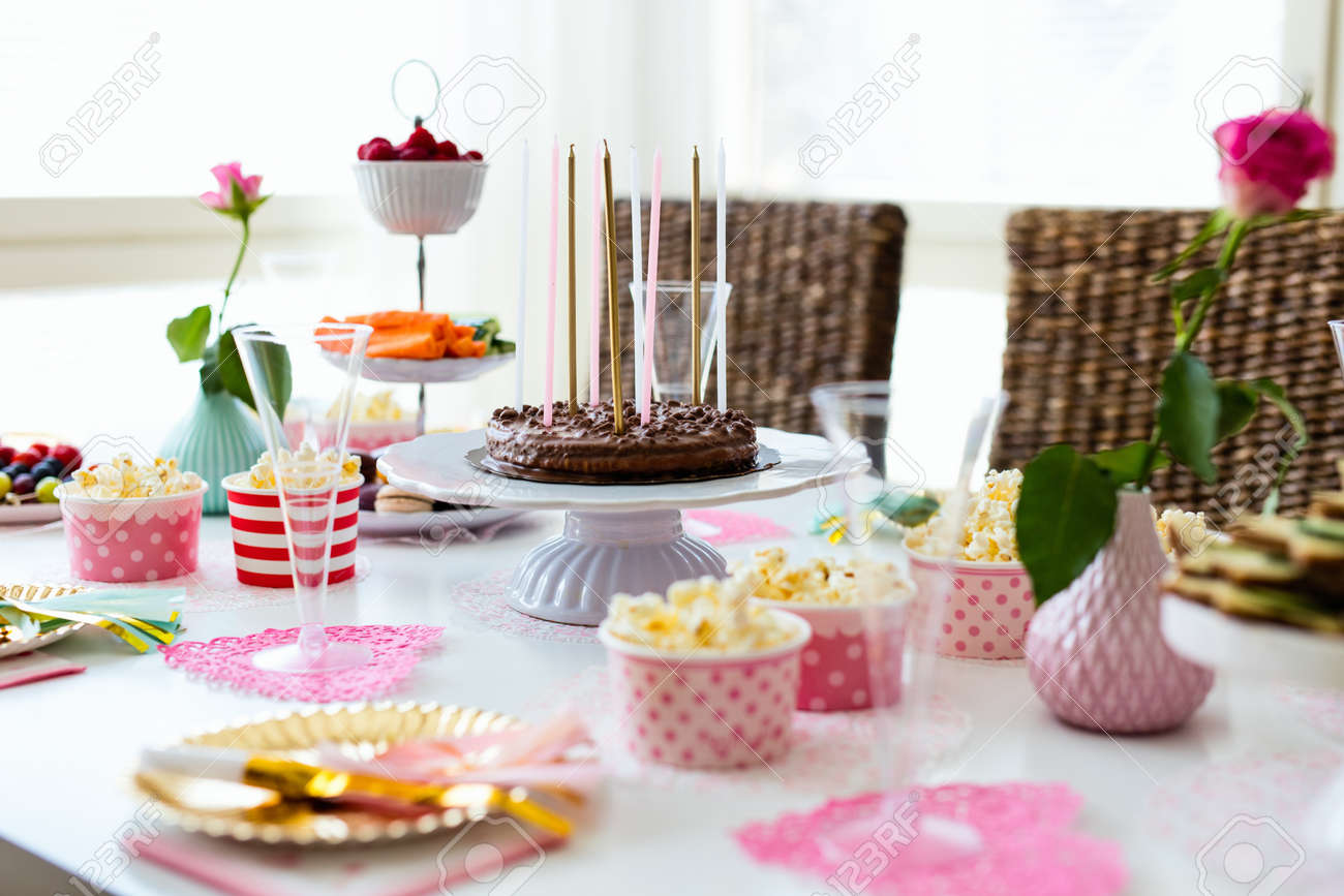 Cake Candies Marshmallows Popcorn Fruits And Other Sweets On Dessert Table At
