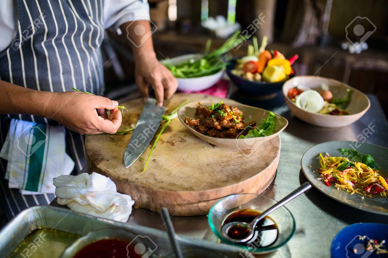 Chef making traditional cambodian meat dish at cooking class - 85191061