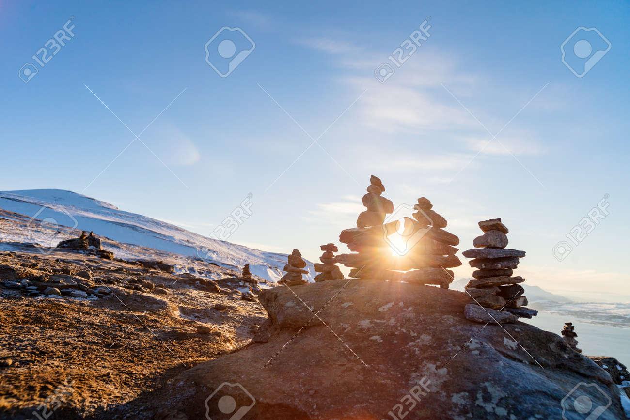Stack of balanced stones on seashore - 107393898