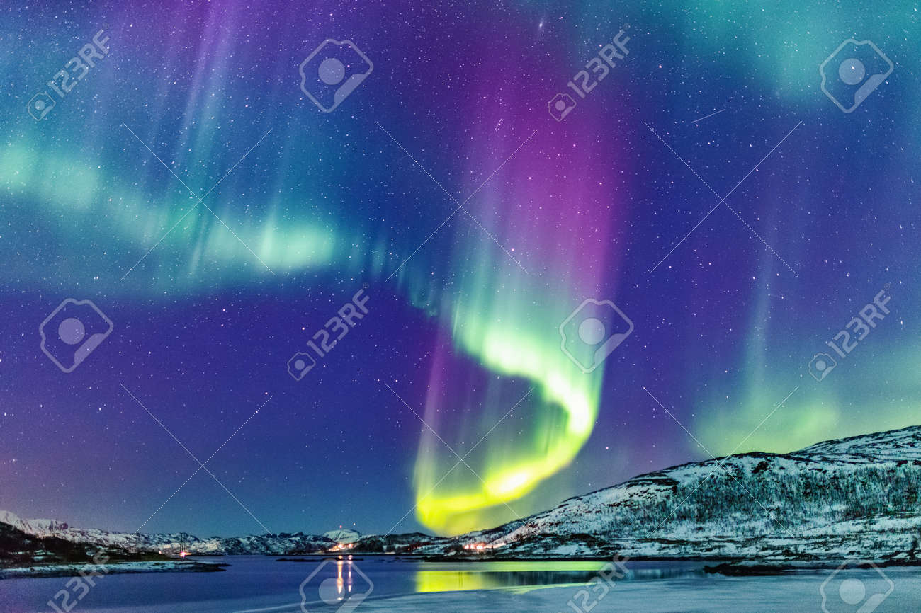 Incredible Northern lights Aurora Borealis activity above the coast in Norway - 107393984