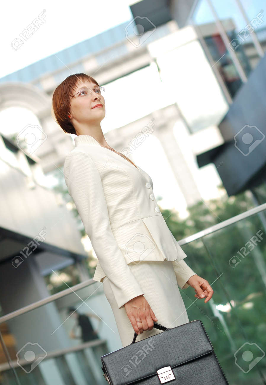 business woman with black briefcase walking street Stock Photo - 5908552