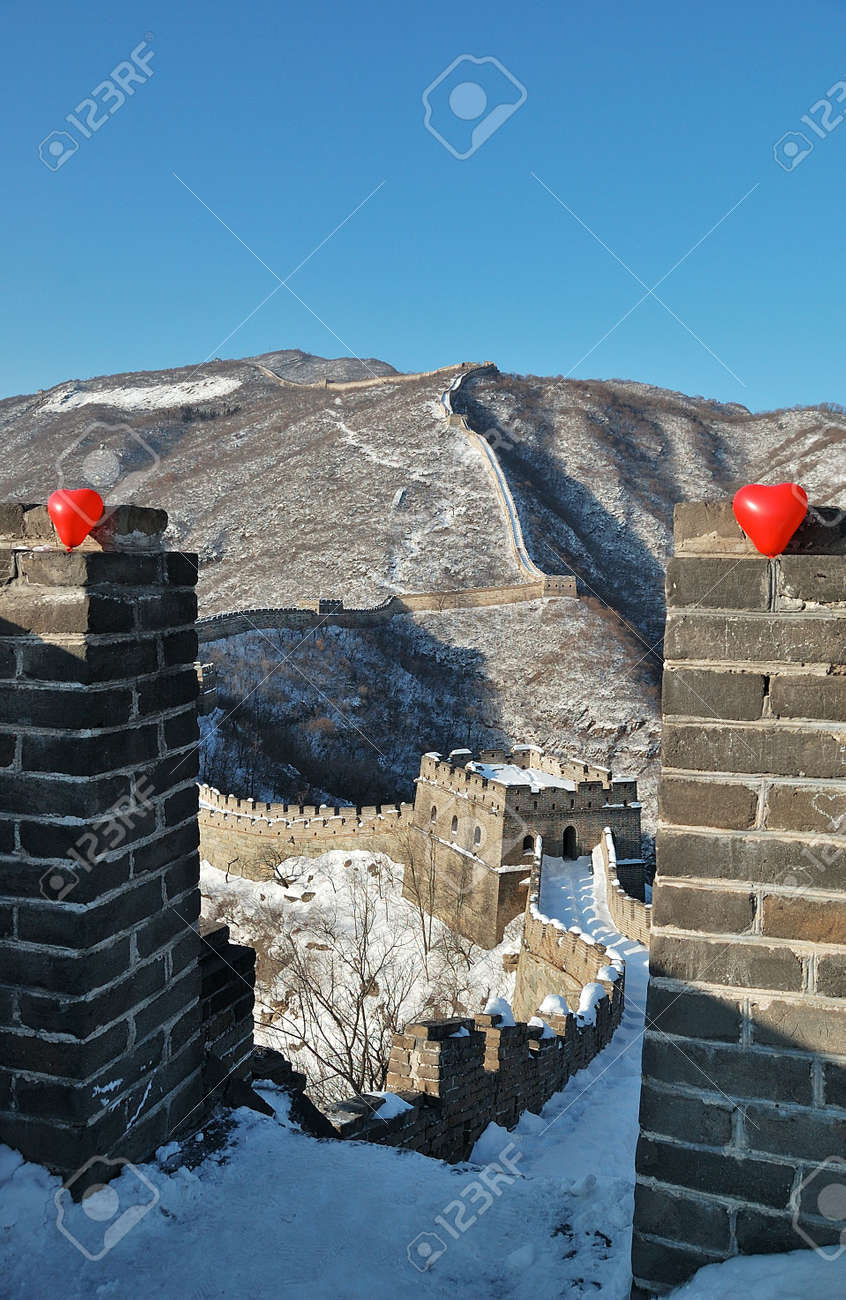 two red balloon in the form of a heart on Great wall in snow Stock Photo - 6182325