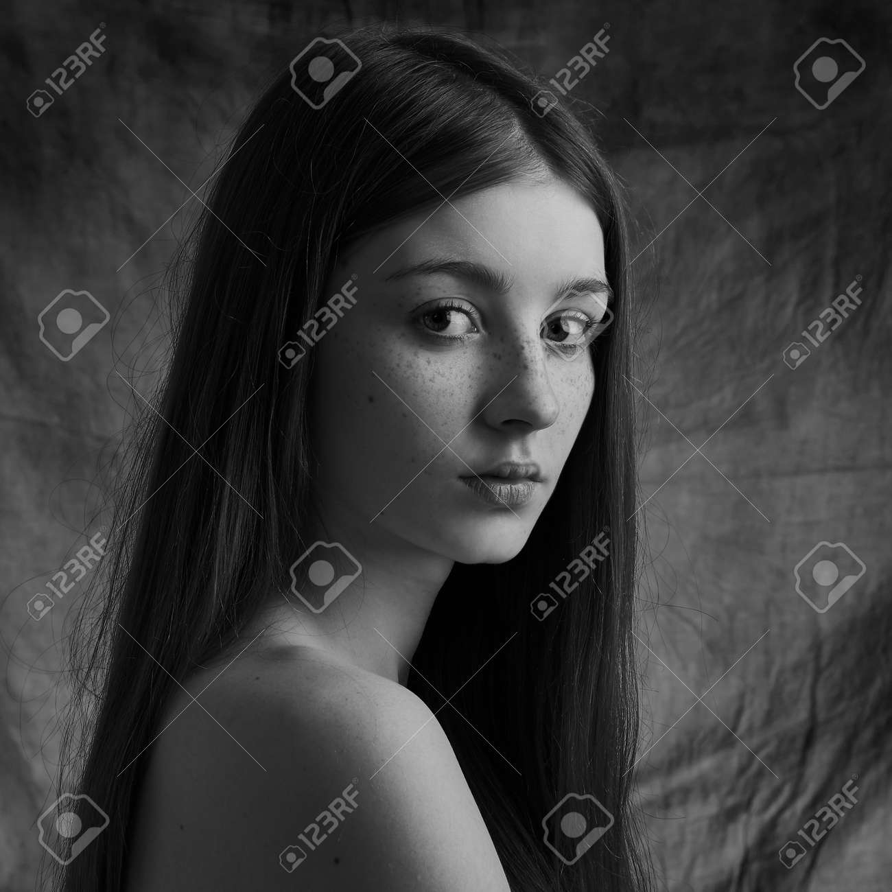 Dramatic black and white portrait of a beautiful lonely girl