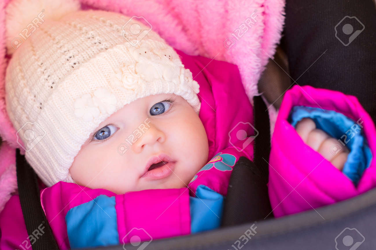 portrait of little baby girl in purple rose jaket and hat Stock Photo -  11620761 9a732e46d6b
