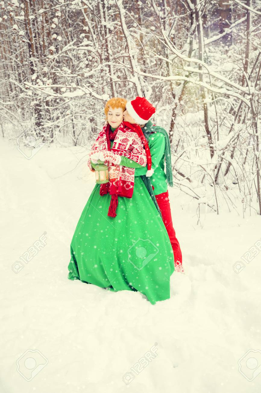 Young Couple Husband And Wife Are Walking In Costumes Of Flowers