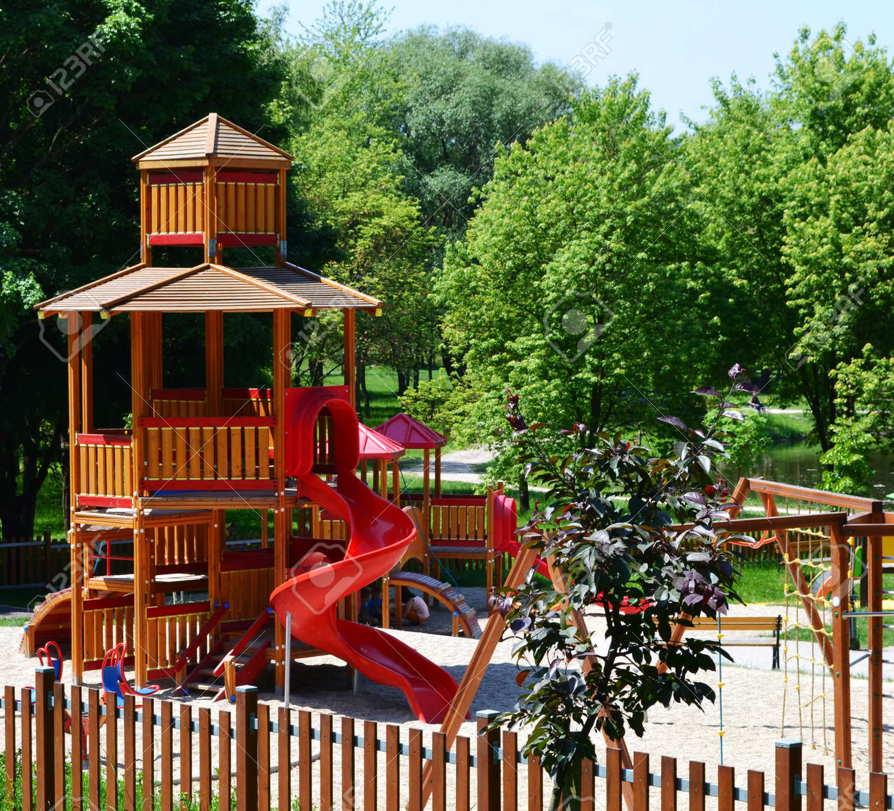 Wooden Castle With Slide On A Modern Playground Situated In