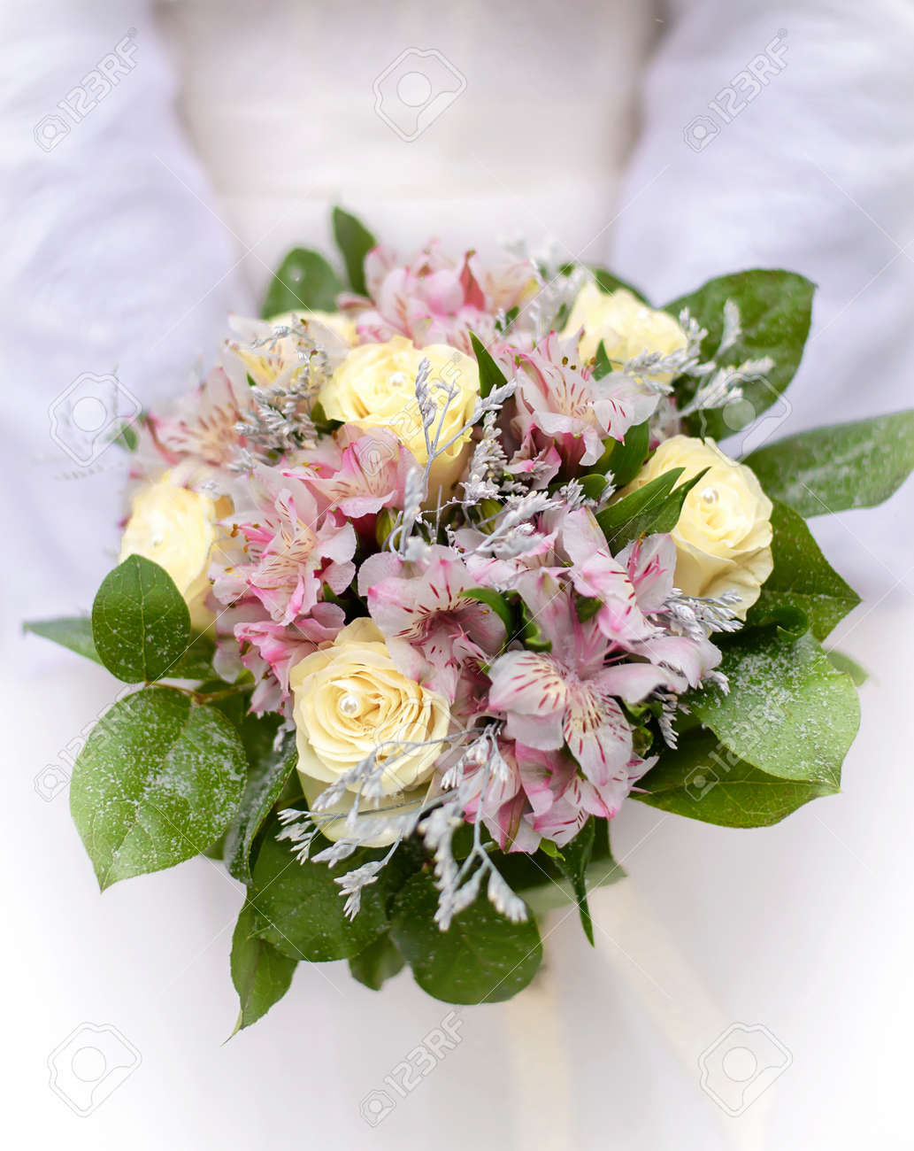 Delicate Wedding Bouquet Of Cream And Pink Flowers In Hands Of Stock Photo Picture And Royalty Free Image Image 73223033
