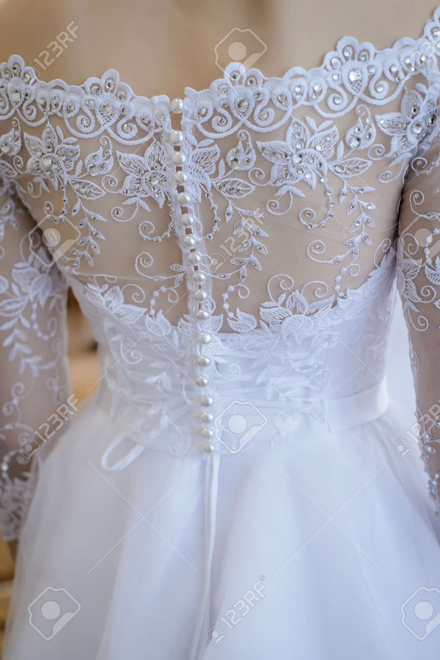 Beautiful Lace Wedding Dress With Lots Of Little White Buttons