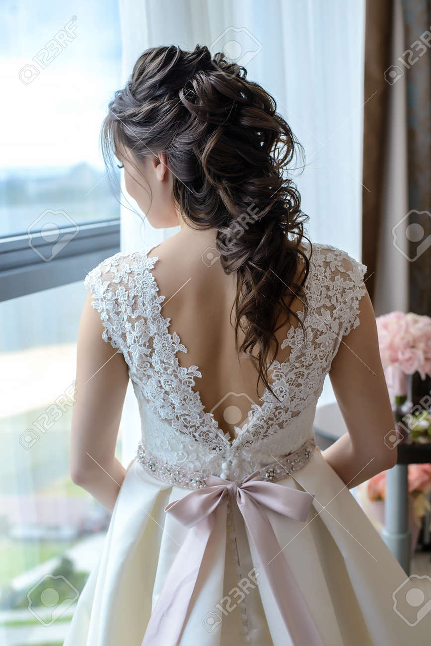Bride With A Beautiful Hairstyle For Long Hair In A White Dress Stock Photo Picture And Royalty Free Image Image 99223058