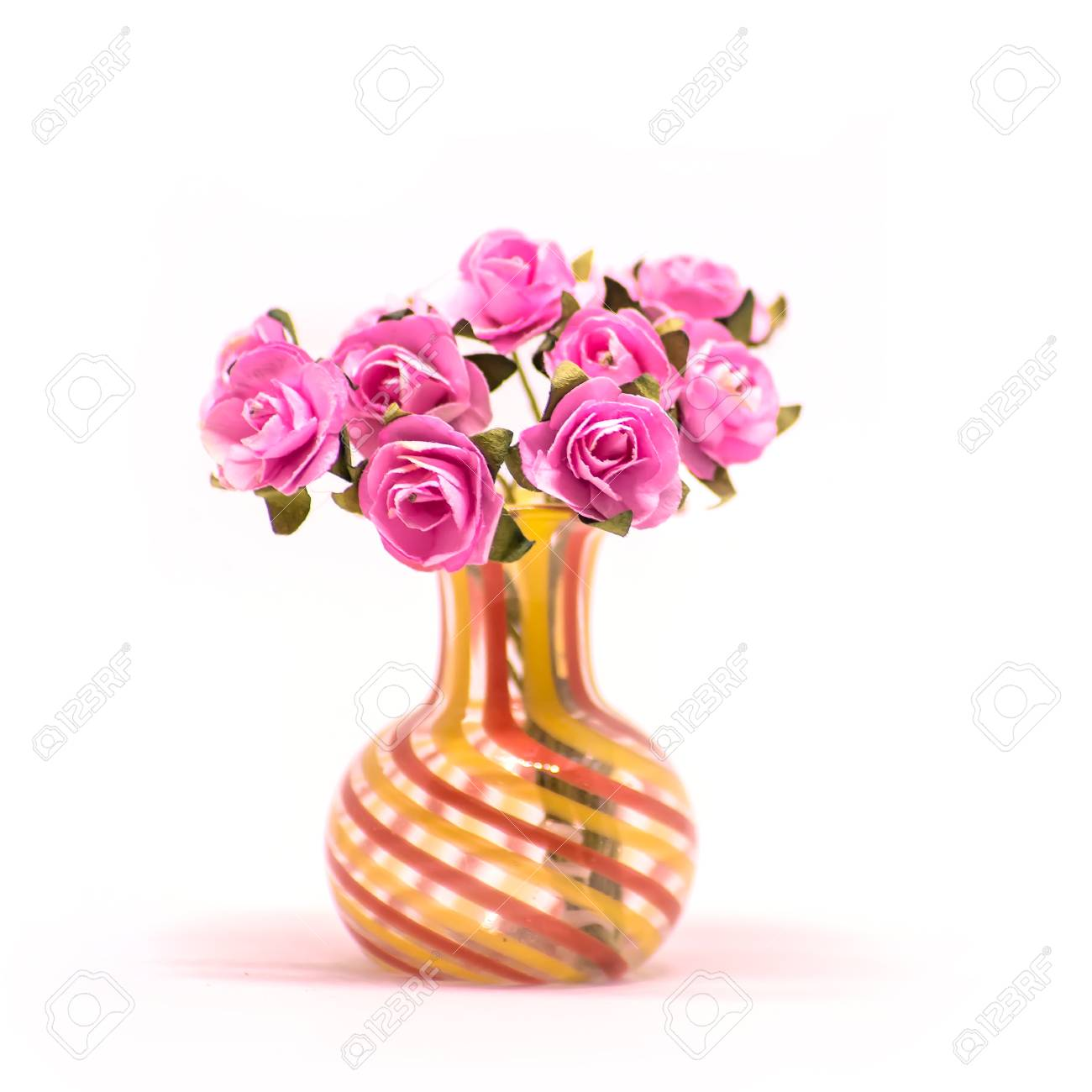 Bouquet Of Artificial Small Pink Roses In A Glass Vase Isolate On A