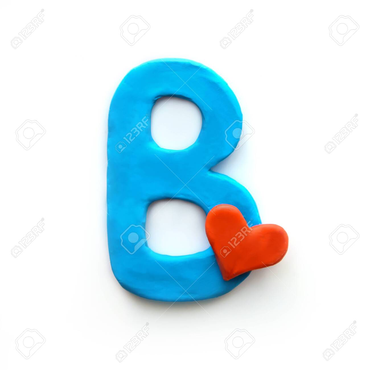 Blue plasticine letter B English alphabet with red heart meaning