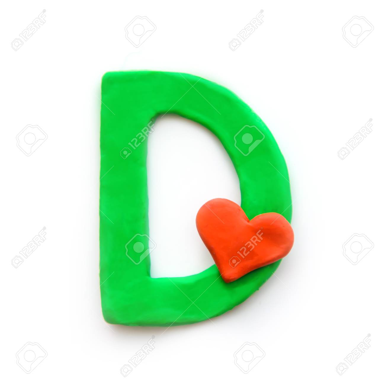 Green plasticine letter D English alphabet with red heart meaning