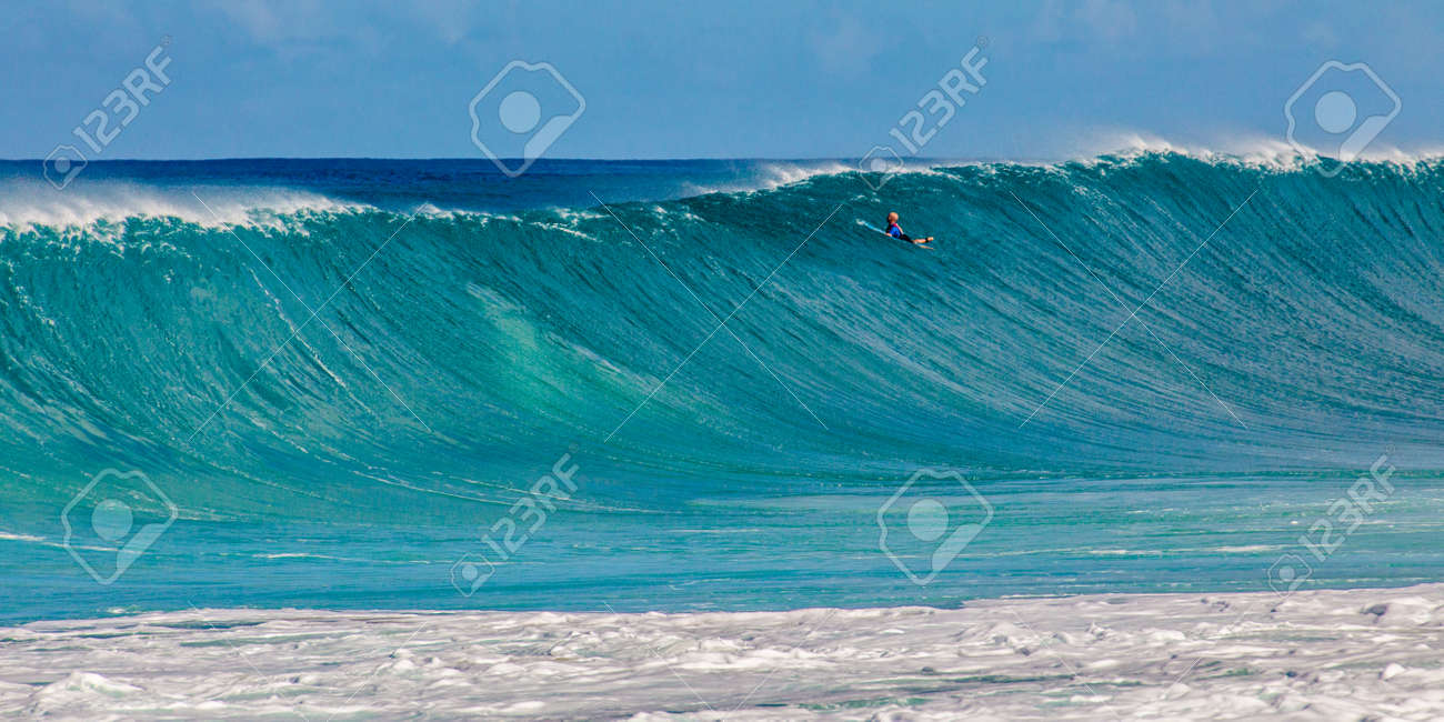 1d21344b3e Stock Photo - Surfer at the world famous Pipeline surf break on North Shore