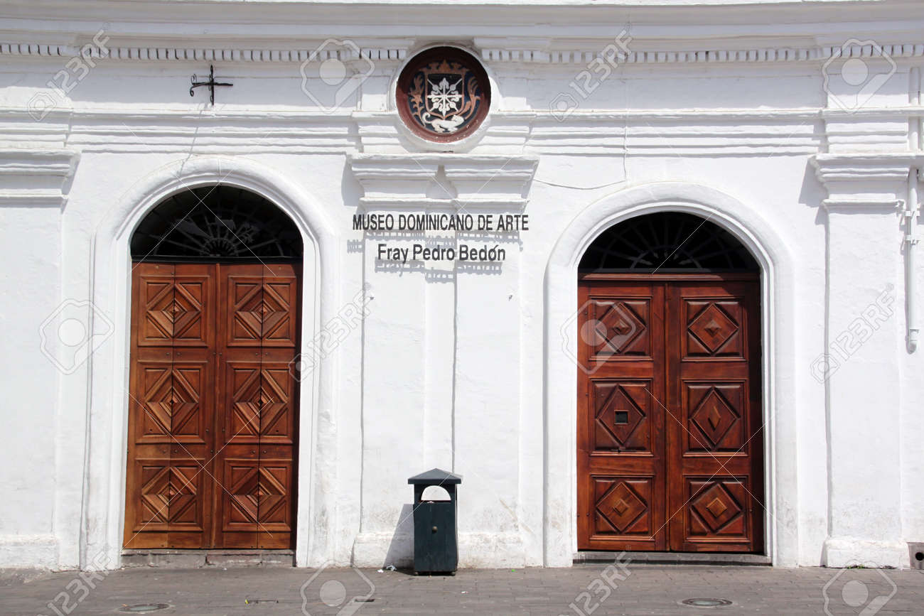 Stock Photo - White wall and two wooden doors of museum in Quito in Ecuador & White Wall And Two Wooden Doors Of Museum In Quito In Ecuador Stock ...