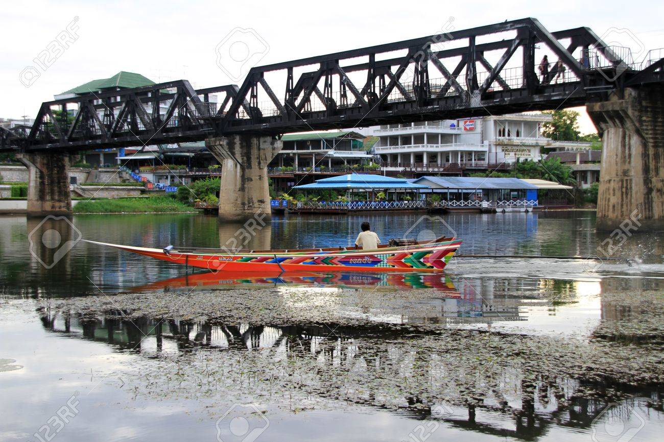 Boat and bridge on the river Kwai, Thailand Stock Photo - 11078682