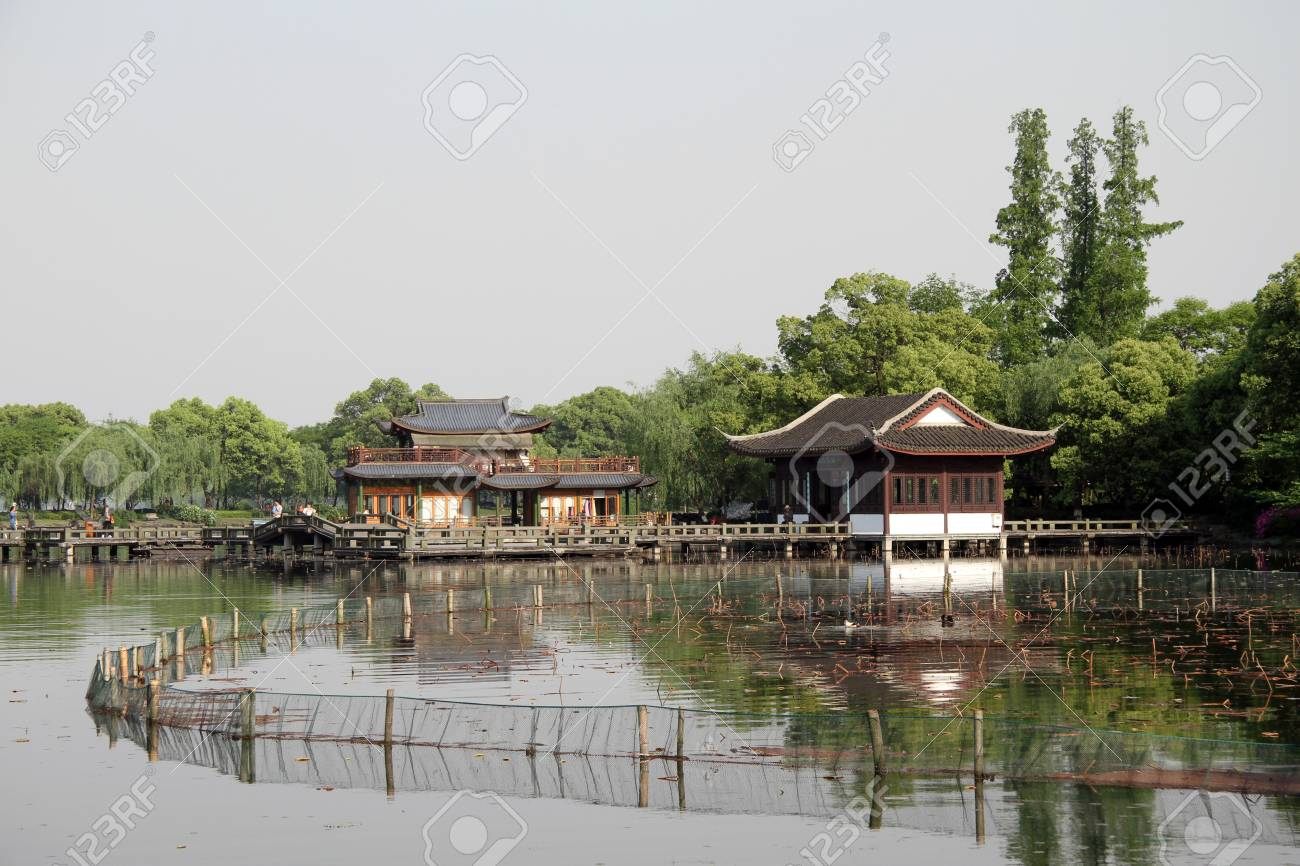 Bridge. buildings and nets on the Western lake in Hangzhou, China Stock Photo - 13852296