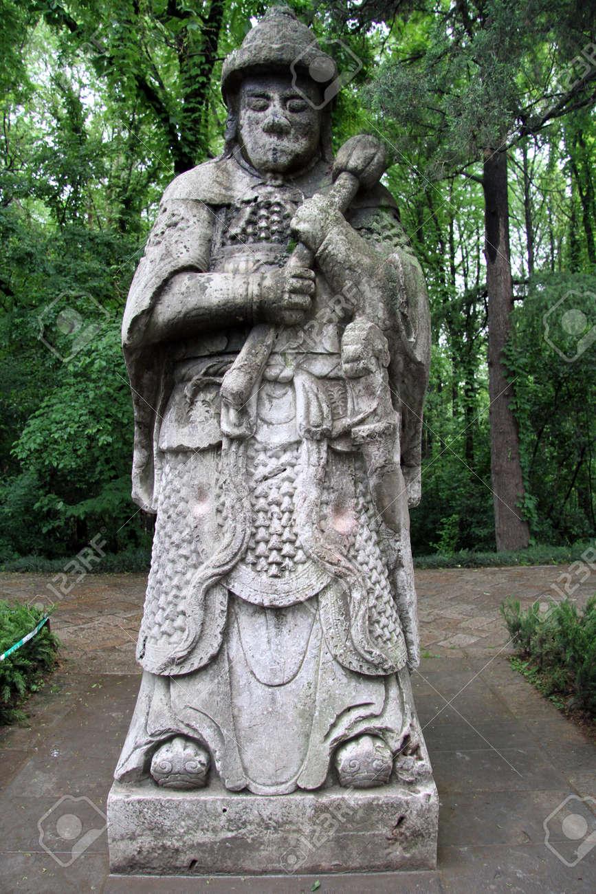 Stone Statue Of Chinese Warrior In The Garden, Nanjing, China Stock Photo    13763154