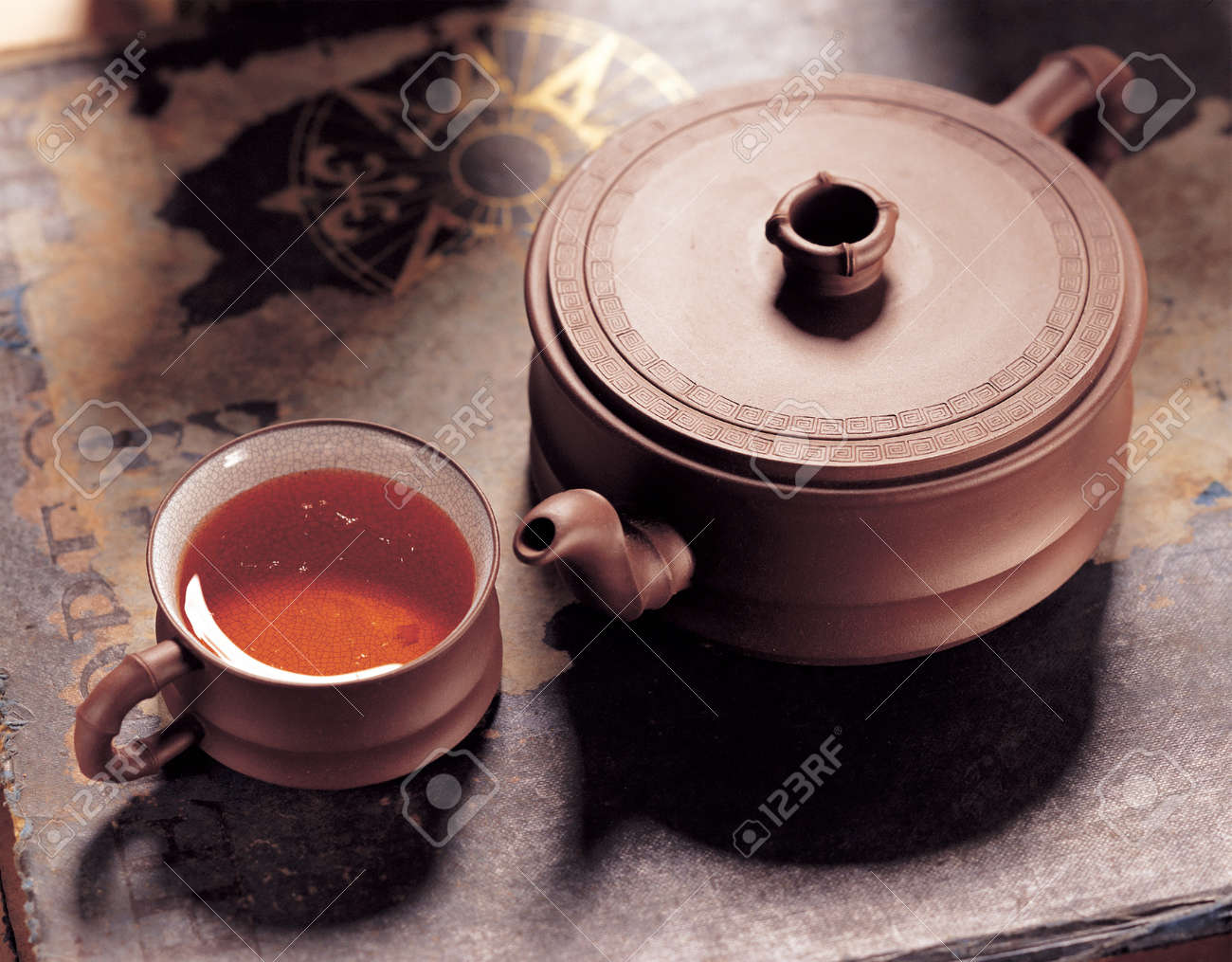Purple pottery teapot and ceramic tea cups. Stock Photo - 10612070