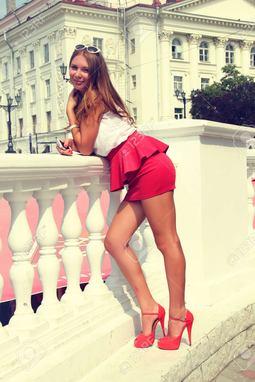 The picture shows a pretty girl in red shoes. Picture taken in a retro style. Stock Photo - 22113034