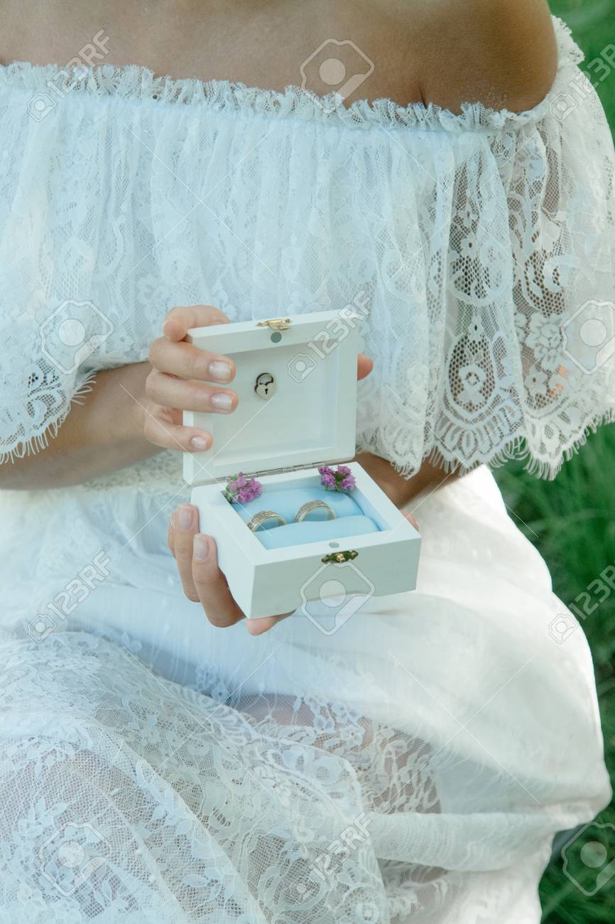 Nice wedding rings in a box in bride hands stock photo picture and nice wedding rings in a box in bride hands stock photo 92316928 junglespirit Gallery