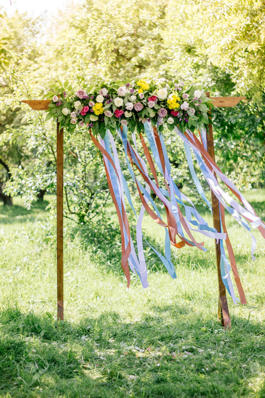 Beautiful Wedding Arch With Flowers On Forest At Summer Day Stock