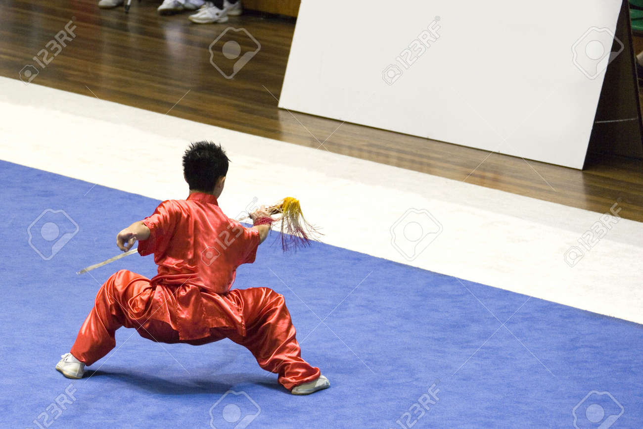 Chinese martial arts exponent in a Wushu competition. Stock Photo - 1815765