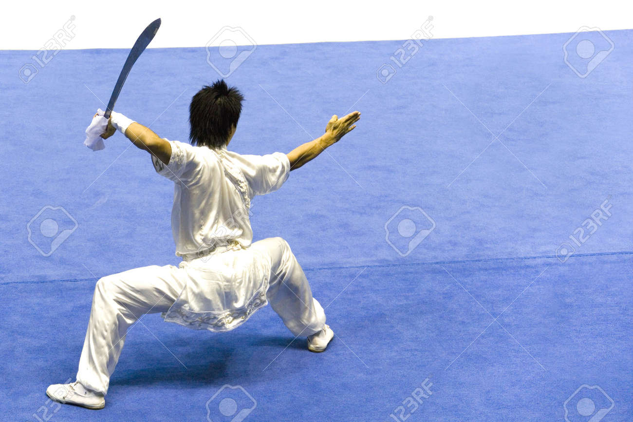 Chinese martial arts exponent in a Wushu competition. Stock Photo - 1827930