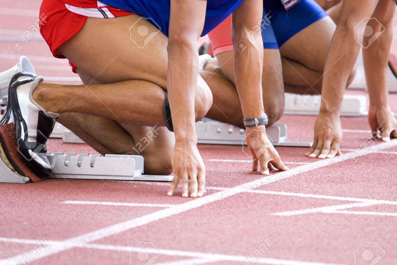 Image of a 100 meters athlete warming-up at the starting block. - 3668412