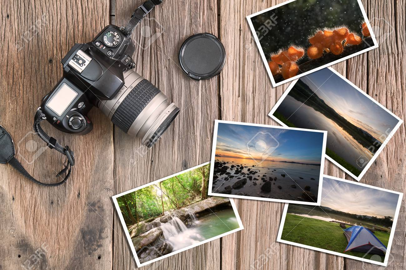 Grunge Camera Vector : Old grunge camera and photos on vintage grunge wooden background