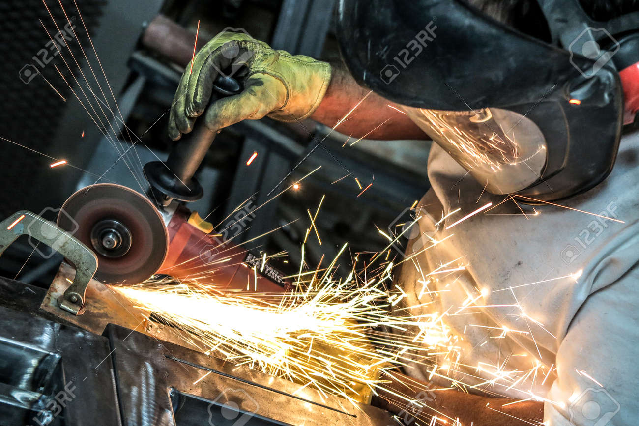 Man Using Angle Grinder Cut Off Wheel To Section Metal Plate Stock Photo Picture And Royalty Free Image Image 81778978