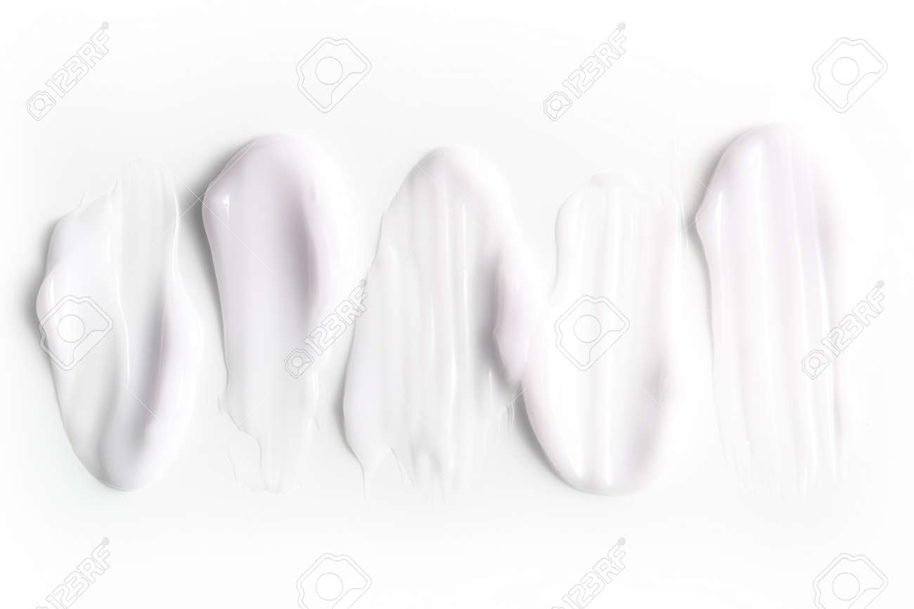 A group of textured strokes of moisturizers on a white background. - 113062701