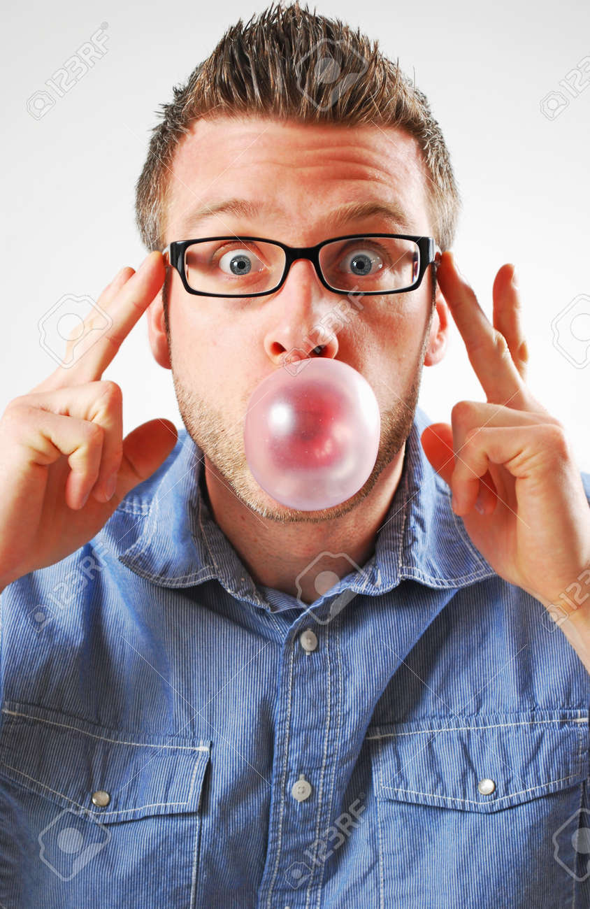 Image of a man blowing a bubble - 13385008