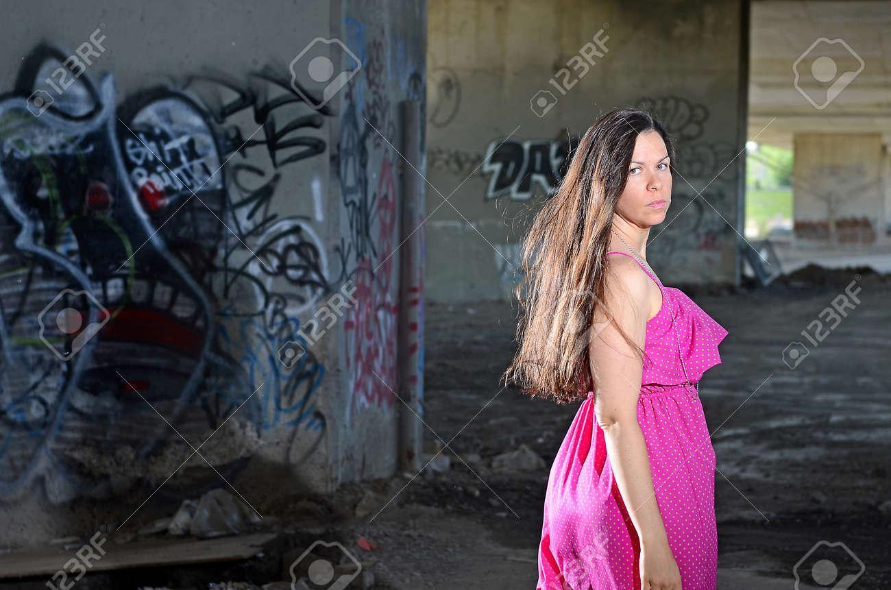 Image of a female posing near graffiti covered walls Stock Photo - 14120605