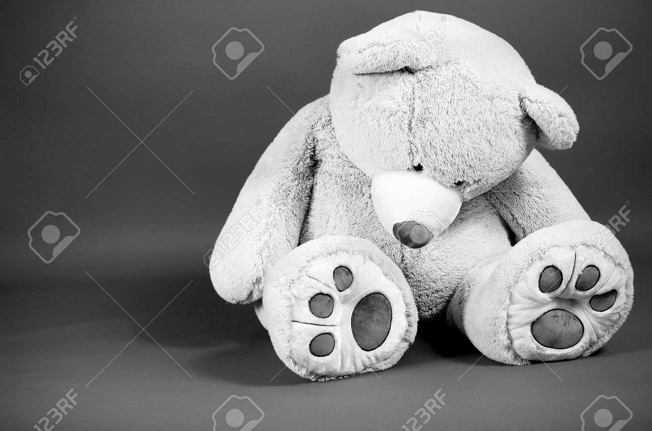 Image of a large sad looking teddy bear - 14408578