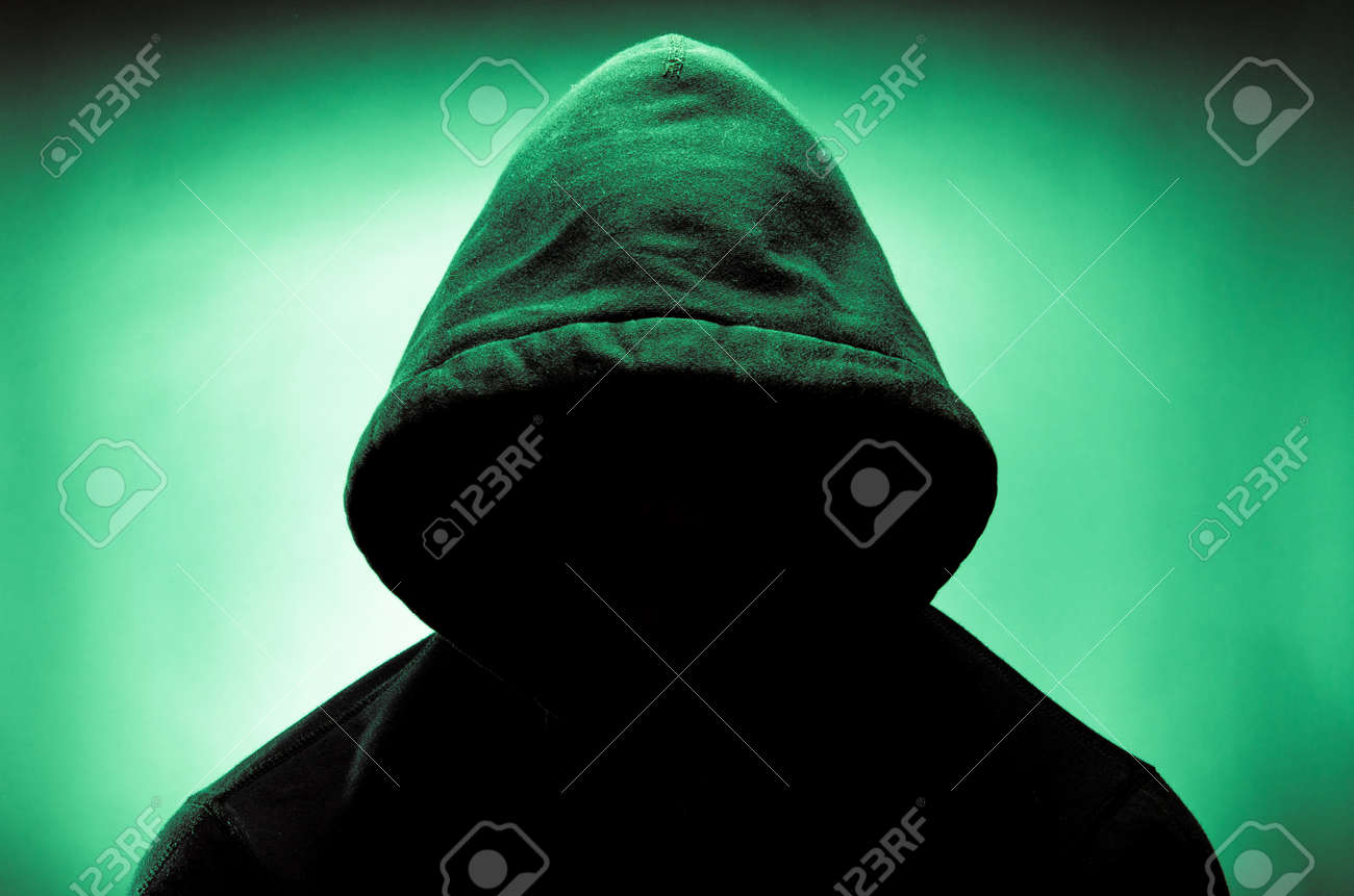 Man wearing hood with face in shadow - 25106460
