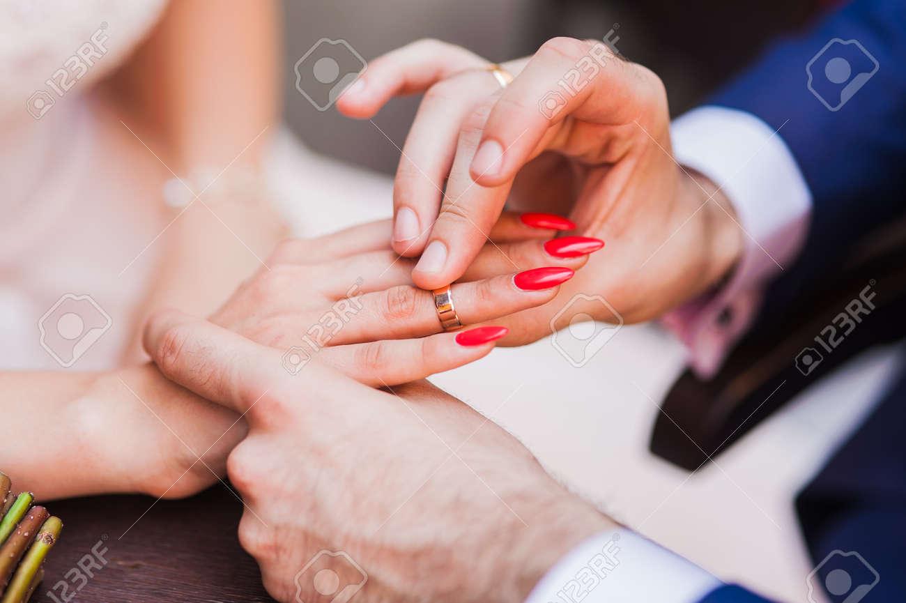 Declarations Of Love. Sharing RING.The Groom Wears Gold Ring.. Stock ...