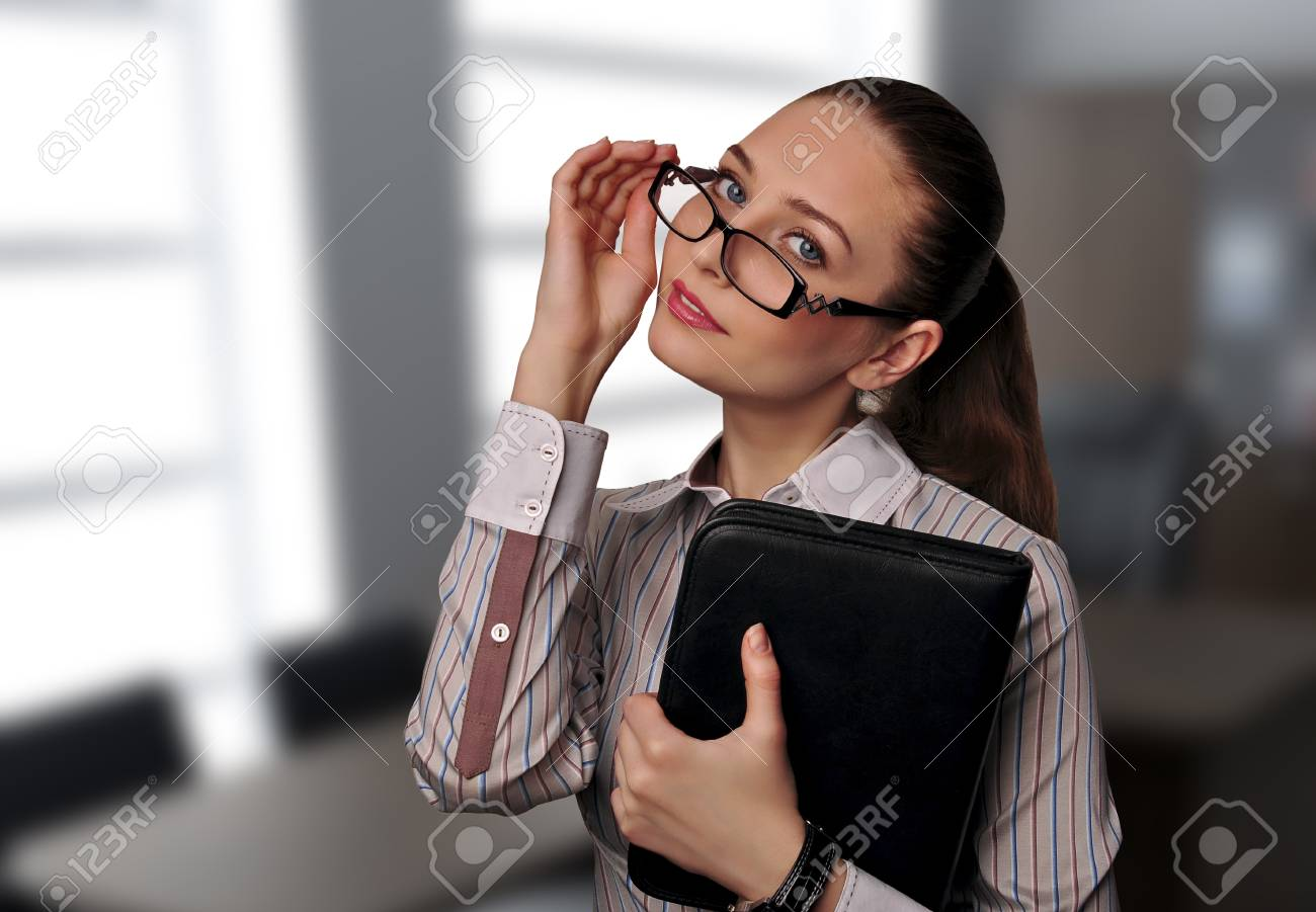 Business woman in glasses with the documents in the office Stock Photo - 12976180