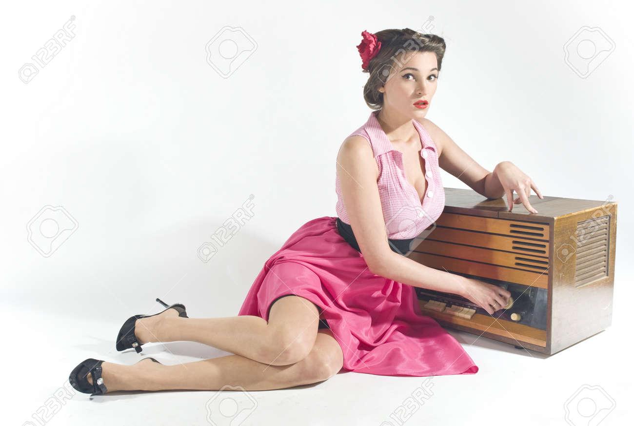 Pin-up girl listen retro radio Stock Photo - 11333914