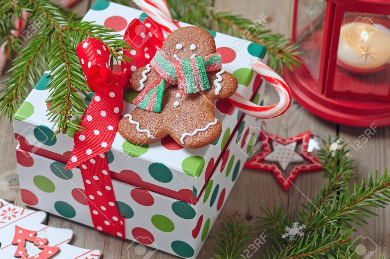 christmas decorations with gingerbread man and gift box stock photo 47999754