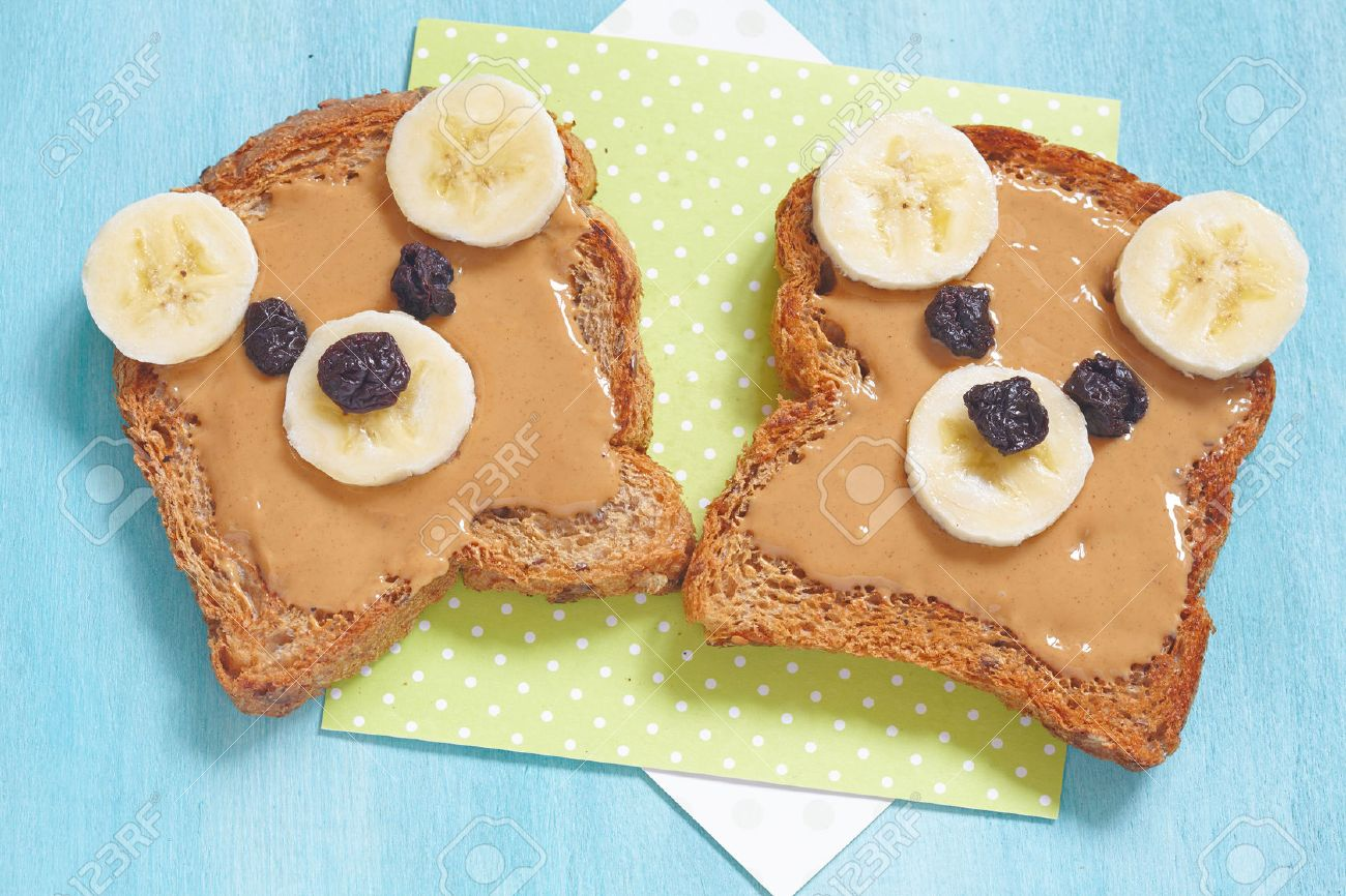 Bear cubs made of whole wheat bread with peanut butter, banana and raisins - 55800327