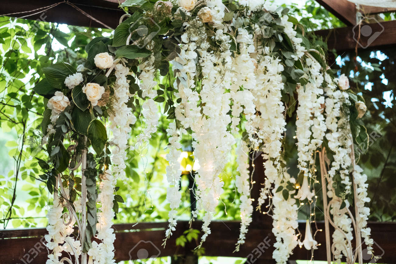 Wedding arch decorated with hanging flowers stock photo picture and stock photo wedding arch decorated with hanging flowers junglespirit Choice Image